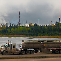 Trucks pass an oil refinery in the eastern slopes of the Canadian Rockies near Edmonton.