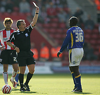 Photo: Lee Earle.<br /> Southampton v Cardiff City. Coca Cola Championship. 21/10/2007. Cardiff's Jimmy Floyd Hasselbaink is shown the red card by ref Alan Wiley.