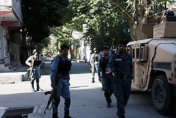 KABUL, Sep. 6, 2016 (Xinhua) -- Afghan policemen stand near the site of bomb blast in Kabul, capital of Afghanistan, Sep. 6, 2016. Gun firing and explosions resumed early Tuesday as security forces were exchanging fire with gunmen who seized a building in central Afghan capital of Kabul, a security source said. (Xinhua/Rahmat Alizadah).****Authorized by ytfs* (Credit Image: © Rahmat Alizadah/Xinhua via ZUMA Wire)