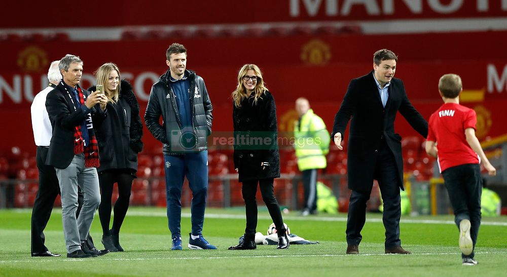 Julia Roberts with her children on the pitch after the Premier League match at Old Trafford, London.