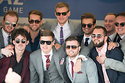 © Licensed to London News Pictures. 06/06/2014. Epsom, UK. A group of men pose for a picture.  Ladies Day today 6th June 2012 at Epsom 2014 Investic Derby Festival in Surrey. Traditionally, elegant, fashionable racegoers gather for a classic day's racing at Epsom Racecourse, Surrey. Photo credit : Stephen Simpson/LNP