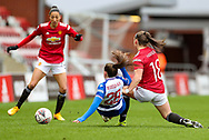 Reading defender Lily Woodham (28) is tackled by Manchester United midfielder Kirsty Hanson (18) during the FA Women's Super League match between Manchester United Women and Reading LFC at Leigh Sports Village, Leigh, United Kingdom on 7 February 2021.