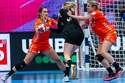 Larissa Nusser of Netherlands, Danick Snelder of Netherlands, Kim Naidzinavicius of Germany during the Women's EHF Euro 2020 match between Netherlands and Germany at Sydbank Arena on december 14, 2020 in Kolding, Denmark (Photo by RHF Agency/Ronald Hoogendoorn)