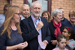 © Licensed to London News Pictures . 24/09/2016 . Liverpool , UK . JEREMY CORBYN is presented with a pink tie during a visit to Beaconsfield Community House in Birkenhead , following his victory declaration . The centre provides clothes and food that would otherwise be destined for waste from supermarkets , to local residents in need . Photo credit : Joel Goodman/LNP