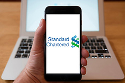 Using iPhone smartphone to display logo of Standard Chartered Bank