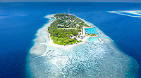 Aerial view of local island Hangnaameedhoo, located in Ari Atoll, Maldives, Indian Ocean with reef, harbour, local beach, bikini / guest beach