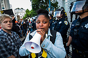 SAN FRANCISCO, CA - MAY 31: Marie Moroe of San Francisco, California pleads with demonstrators to leave the scene before an imposed curfew, during a protest over the police killing of George Floyd, outside City Hall in San Francisco, California on May 31, 2020. - The United States has erupted into days and nights of protests, violence, and looting, following the death of George Floyd after he was detained and held down by a knee to his neck, dying shortly after. (Photo by Philip Pacheco / Agence France-Presse / AFP)