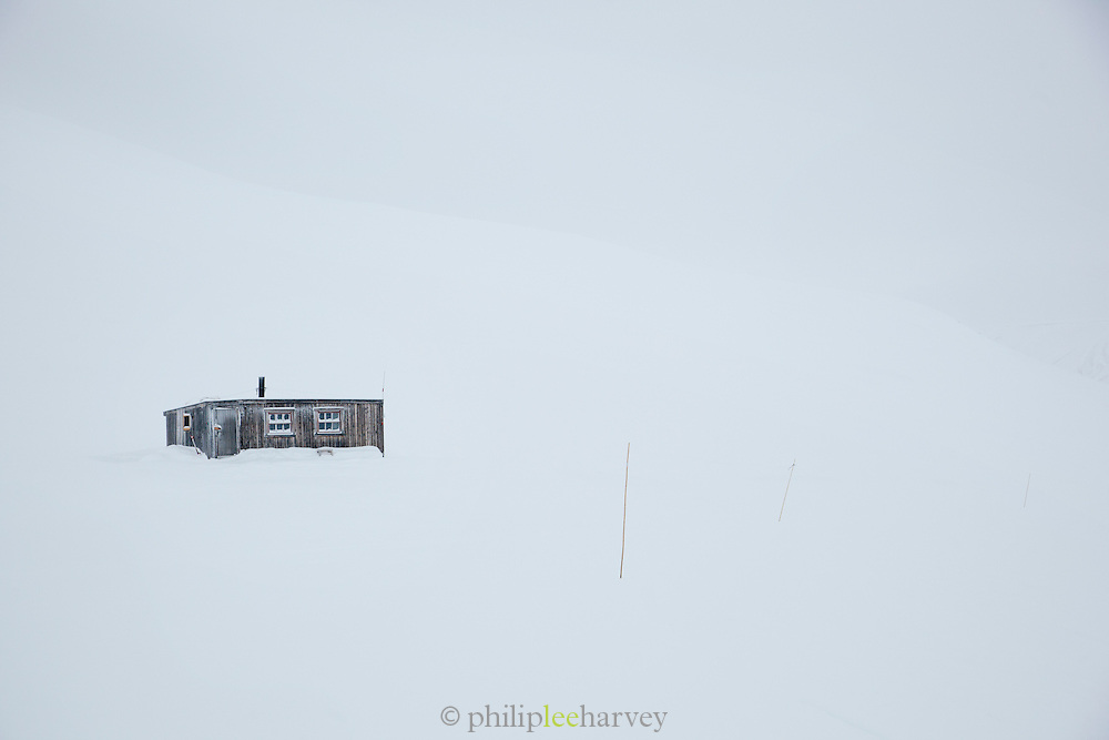 Cabins placed in the wilderness to help people who get stuck in snow storms or bad conditions, in Spitsbergen. Spitsbergen is the largest island of the arctic archipelago Svalbard, of Norway