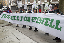 © Licensed to London News Pictures. 27/01/2020. London, UK.  Protesters gather as phase two of the Grenfell Inquiry starts. The second part of the inquiry into the fire that claimed the lives of 72 residents will consider important wider issues around the refurbishment and management of the Tower. Photo credit: Peter Macdiarmid/LNP