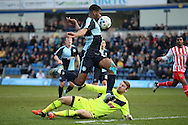 Rowan Liburd of Wycombe Wanderers jumps over Goalkeeper Jamie Jones of Stevenage to attempt to score. Skybet football league two match, Wycombe Wanderers  v Stevenage Town at Adams Park  in High Wycombe, Buckinghamshire on Saturday 12th March 2016.<br /> pic by John Patrick Fletcher, Andrew Orchard sports photography.