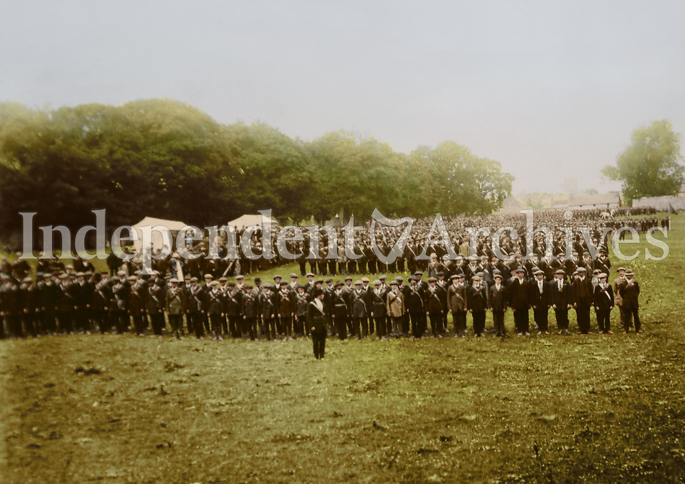 """A rally of the Irish National Volunteers in Athenry, Galway. This photo was taken on 29 June 1914 and appeared in the Sunday Independent on 5 July 1914. The original caption from 5 July 1914 was """"View of main section of the massed drill display by 2,200 Irish National Volunteers of Co. Galway assembled in Sports Field. Athenry."""" (Part of the Independent Newspapers Ireland/NLI Collection) Colourised by Tom Marshall (PhotograFix)."""
