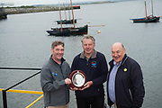 02/07/2017 REPRO FREE: Dr. Peter Heffernan CEO Marine Institute presenting Colin Hernon with the trophy for winning the Hooker race at  Seafest 2017, the National Maritime Festival which ran in Galway and John Killeen Chairman Seafest.<br /> . Photo:Andrew Downes, xposure .