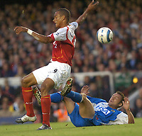 SPORTSBEAT 01494 783165<br />PICTURE ADY KERRY .<br />ARSENAL VS BLACKBURN<br />25TH AUGUST<br />ARSENAL'S GILBERTO JUMPS OVER A CHALLENGE FROM PAUL DICKOV