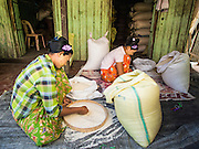 10 NOVEMBER 2014 - SITTWE, MYANMAR: Women sift rice in the rice market in Sittwe, Myanmar. Sittwe is a small town in the Myanmar state of Rakhine, on the Bay of Bengal.    PHOTO BY JACK KURTZ