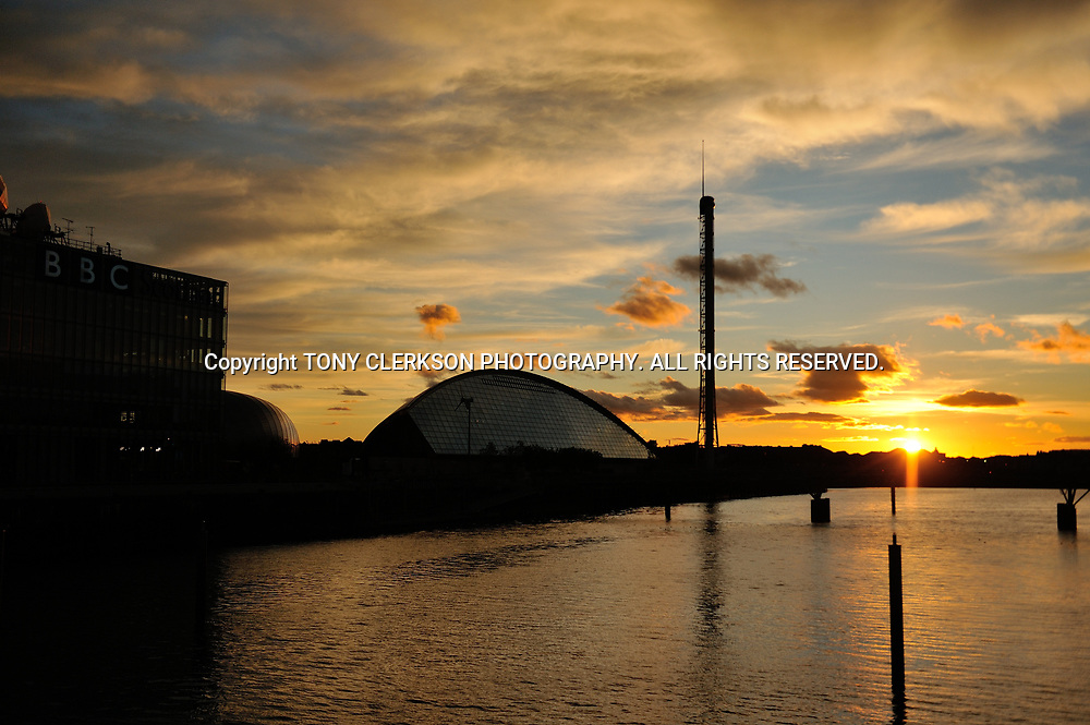Sunset over the River Clyde, with the BBC and the Science Centre silhoutted against the glowing sky