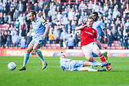 Mike-Steven Bahre of Barnsley (21) is fouled by Charlie Wakefield of Coventry City (44) off the ball during the EFL Sky Bet League 1 match between Barnsley and Coventry City at Oakwell, Barnsley, England on 30 March 2019.