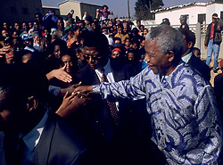 1994 - Kliptown, Soweto, South Africa - NELSON MANDELA greets people during his campaign tour leading up to the 1994 elections. .(Credit Image: © Greg Marinovich/ZUMA Wire/ZUMAPRESS.com)