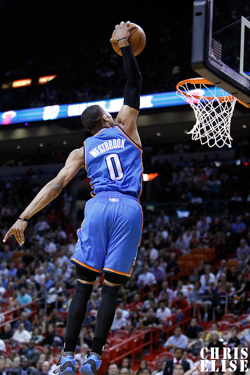 16 March 2011: Oklahoma City Thunder point guard Russell Westbrook (0) dunks the ball during the Oklahoma City Thunder 96-85 victory over the Miami Heat at the AmericanAirlines Arena, Miami, Florida, USA.
