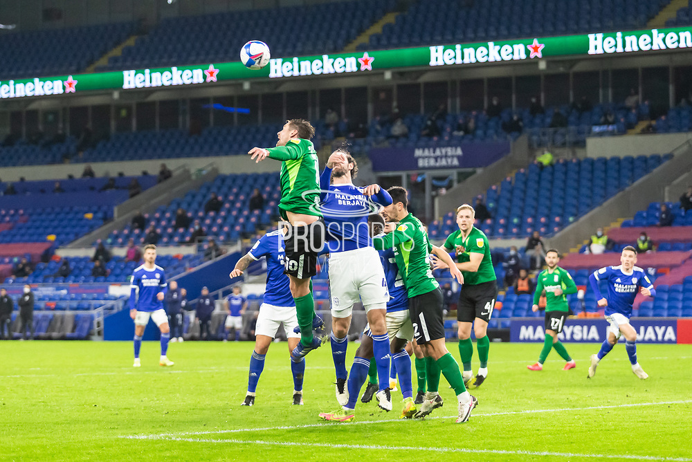 Birmingham City's Lukas Jutkiewicz (10) competes for a high ball with Cardiff City's Sean Morrison (4) during the EFL Sky Bet Championship match between Cardiff City and Birmingham City at the Cardiff City Stadium, Cardiff, Wales on 16 December 2020.