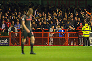 Crawley Town fans wave Stoke City player Lasse Sorensen off after he is given a red card in the second half during the EFL Cup match between Crawley Town and Stoke City at The People's Pension Stadium, Crawley, England on 24 September 2019.
