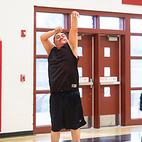 Frasier Begay with a jump shot for Diné College, Saturday, Feb. 2 at Navajo Technical University (NTU) in Crownpoint in a staff and faculty basketball game between NTU and Diné College.