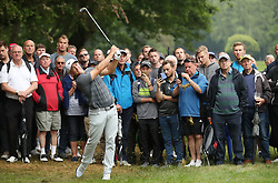 Sweden's Alex Noren plays from the rough on the fourth during day one of the 2018 BMW PGA Championship at Wentworth Golf Club, Surrey
