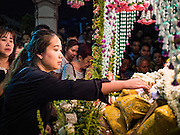 25 MARCH 2016 - BANGKOK, THAILAND: A woman reaches out to touch the hand of a statue of Jesus during Good Friday observances at Santa Cruz Church in Bangkok. Santa Cruz was one of the first Catholic churches established in Bangkok. It was built in the late 1700s by Portuguese soldiers allied with King Taksin the Great in his battles against the Burmese who invaded Thailand (then Siam). There are about 300,000 Catholics in Thailand, in 10 dioceses with 436 parishes. Good Friday marks the day Jesus Christ was crucified by the Romans and is one of the most important days in Catholicism and Christianity.      PHOTO BY JACK KURTZ