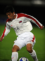 La Roche sur Yon FC Nantes v Korea  DPR (0-0) 09/10/2009<br /> Ji Yun Nam ( DPR Korea)<br /> North Korea make a rare appearance in the West having already qualified for World Cup 2010. Their last appearance in a major competiition was World Cup 1966 when they famously knocked Italy out of the tournament.<br /> Photo Roger Parker Fotosports International
