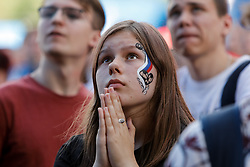 June 25, 2018 - Saint Petersburg, Russia - Russia supporters watch the game during the FIFA World Cup 2018 match between Russia and Uruguay on June 25, 2018 at Fan Fest zone in Saint Petersburg, Russia. (Credit Image: © Mike Kireev/NurPhoto via ZUMA Press)
