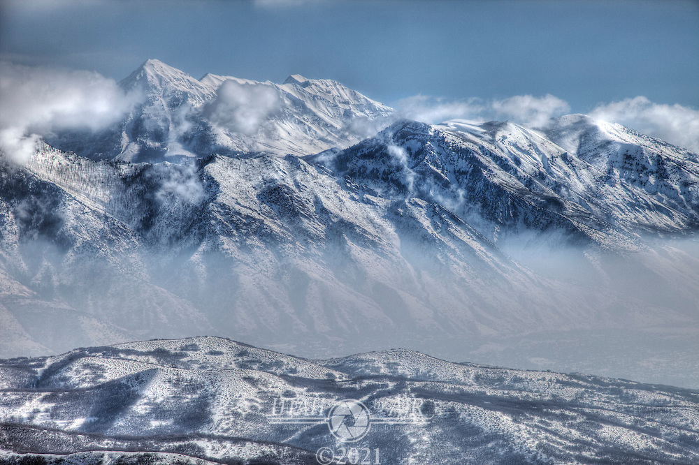 Wasatch Mountains rising above the inversion layer of Utah County