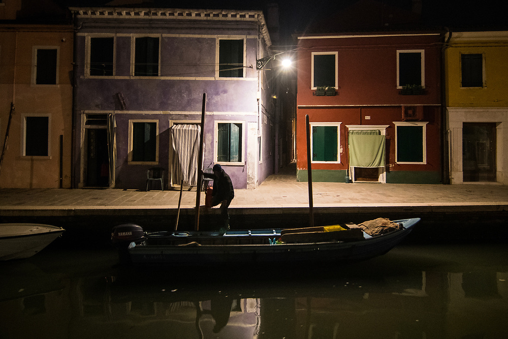 VENICE, ITALY - APRIL 2018. <br /> Emiliano, a moecante (crabs fisherman) of the island of Burano, starts at 3 am with his boat to make his first checking tour of the fishing nets out in the Venetian lagoon. Every day the fishermen start at this hour, and they work untill late afternoon, knowing that there is just a month for the catching of the Moeche.