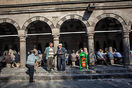 Male Kayserians gather at the Ulu Camii mosque to perform abultions in Kayseri's old city before Friday prayers. The industrial city is located in central Anatolia, Turkey.