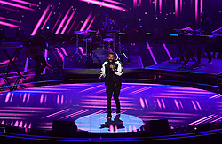 Craig David performs at the Royal Albert Hall in London during a star-studded concert to celebrate the Queen's 92nd birthday.