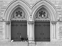 Homeless man on the steps of a church on Central Park West in New York City