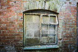 A bricked up metal framed window at the Nag's Head Cottage in Imber village on Salisbury Plain, Wiltshire, where residents were evicted in 1943 to provide an exercise area for US troops preparing to invade Europe. Roads through the MoD controlled village are now open and will close again on Monday August 22.