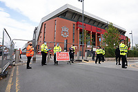 Football - 2019 / 2020 Premier League - Liverpool vs Aston Villa<br /> <br /> Stewards and Police control access to the stadium, at Anfield.<br /> <br /> COLORSPORT/TERRY DONNELLY