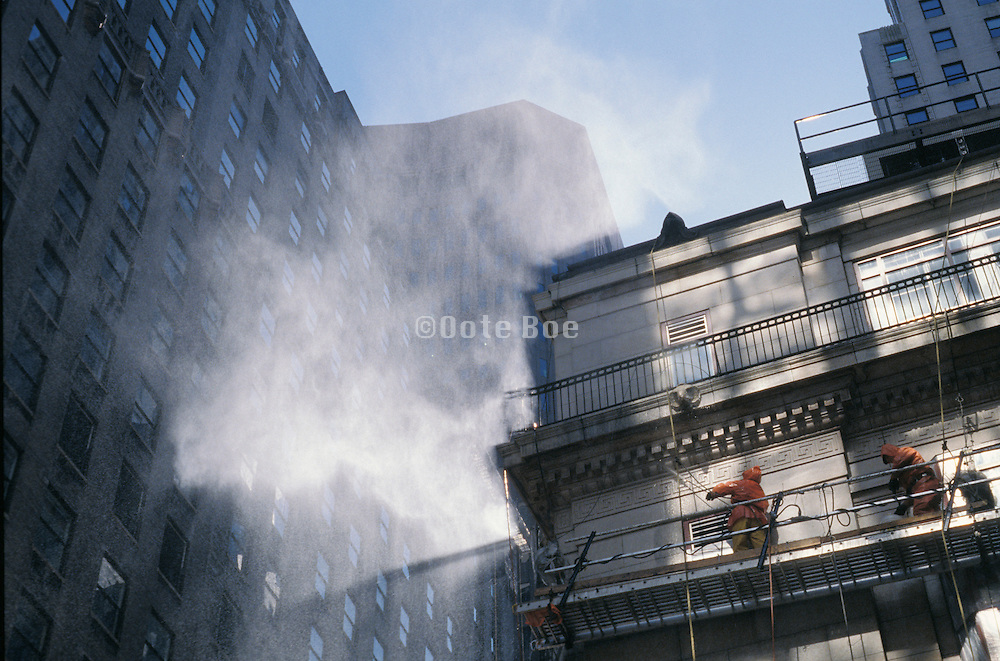 workmen cleaning a building