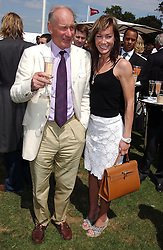 MR CHARLES PALMER-TOMKINSON and his daughter MISS TARA PALMER-TOMKINSON at the 2004 Cartier International polo day at Guards Polo Club, Windsor Great Park, Berkshire on 25th July 2004.