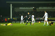 Referee Matthew Donohue blows for a free kick as two Burton players lay injured during the EFL Sky Bet League 1 match between Burton Albion and Coventry City at the Pirelli Stadium, Burton upon Trent, England on 17 November 2018.