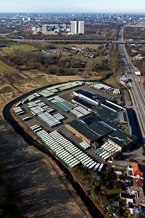 Nederland, Utrecht, De Bilt, 07-03-2010;   Utrechtseweg met parkeerterrein en garage van Connexion. Skyline van Utrecht in het verschiet..luchtfoto (toeslag), aerial photo (additional fee required).foto/photo Siebe Swart