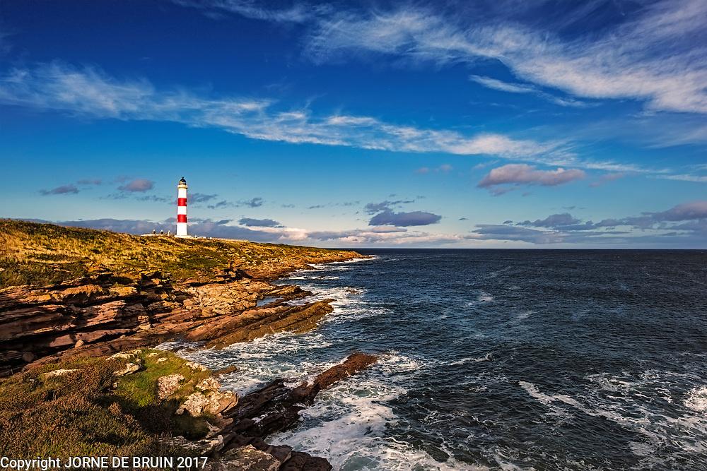 Tarbat Ness Lighthouse in the afternoon sun on the North Sea Coast, Scotland.