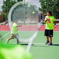 061814       Cable Hoover<br /> <br /> Rocco James Jr and Caitlin James practice their passing shots during the Gallup Bengals tennis camp at Ford Canyon Park in Gallup Wednesday.