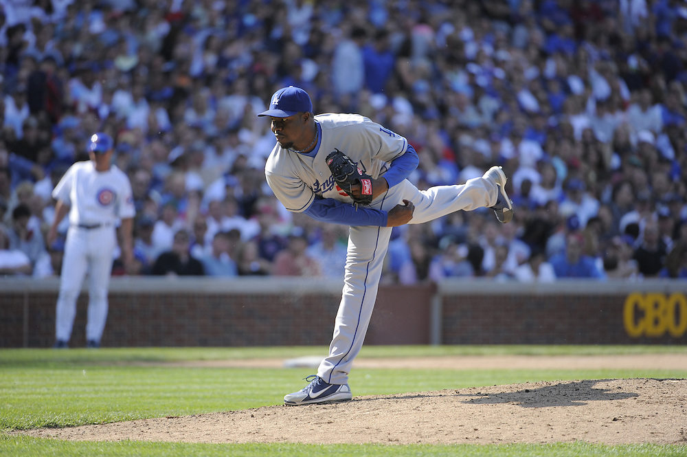 CHICAGO - MAY 30:  Guillermo Mota #59 of the Los Angeles Dodgers pitches against the Chicago Cubs on May 30, 2009 at Wrigley Field in Chicago, Illinois.  The Cubs defeated the Dodgers 7-0.  (Photo by Ron Vesely)