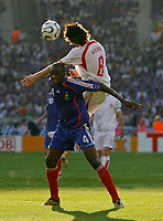 Photo: Glyn Thomas.<br />France v Switzerland. Group G, FIFA World Cup 2006. 13/06/2006.<br /> Switzerland's Raphael Wicky (R) climbs above Patrick Vieira.