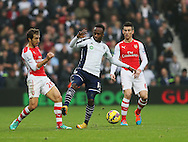 West Brom's Saido Berahino tussles with Arsenal's Mathieu Flamini<br /> <br /> Barclays Premier League- West Bromwich Albion vs Arsenal - The Hawthorns - England - 29th November 2014 - Picture David Klein/Sportimage