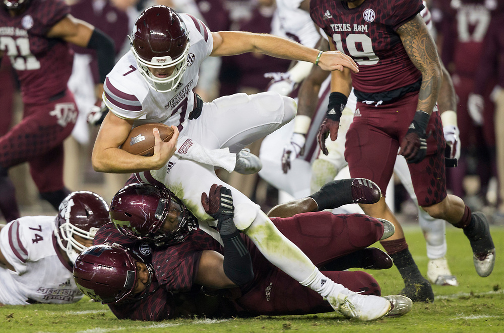 Mississippi State quarterback Nick Fitzgerald (7) is tackled by Texas A&M defensive back Donovan Wilson (6) during the second quarter of an NCAA college football game on Saturday, Oct. 28, 2017, in College Station, Texas. (AP Photo/Sam Craft)