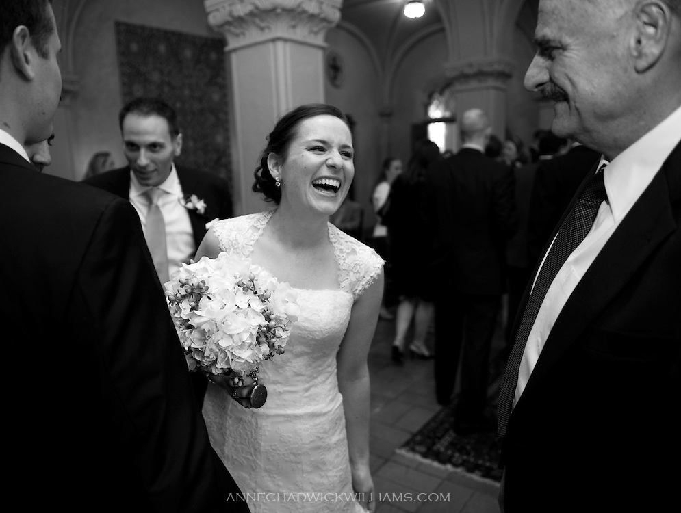A bride and groom talk with guests at their reception at the Berkeley City Club.