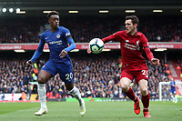 Football - 2018 / 2019 Premier League - Liverpool vs. Chelsea<br /> <br /> Callum Hudson Odoi of Chelsea and Andy Robertson of Liverpool, at Anfield.<br /> <br /> COLORSPORT/PAUL GREENWOOD