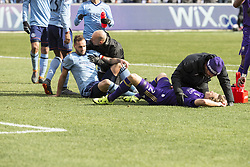 March 17, 2018 - New York, New York, United States - Jonathan Spector (2) of Orlando City SC and Maxime Chanot (4) of NYC FC assisted by medical staff after collision during regular MLS game at Yankee stadium NYC FC won 2 - 0 (Credit Image: © Lev Radin/Pacific Press via ZUMA Wire)
