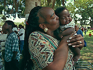 A kiss of love comes from the heart of Gladys Bivins (cq), grandmother of Ian Latson (cq), 2 months, during the 11th annual gospel celebration in Hagginwod Park, Saturday  August 7, 1999.  Gladys belongs to the Pearly Gates Missionary Baptist Church.